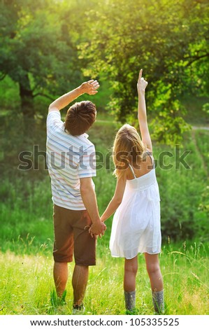 a young couple in love outdoors - stock photo
