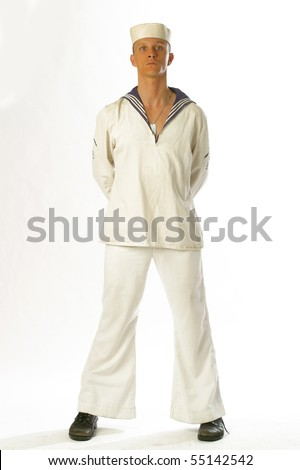 A young sailor man poses in the studio - stock photo