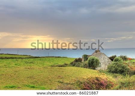 Abandoned Irish house at sunset in Doolin, Ireland. - stock photo