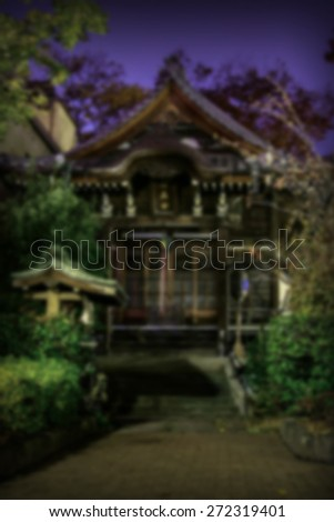 """Abstract Background Blurred Image"" Traditional Japanese shrine structure at night.  (Blur style image) - stock photo"