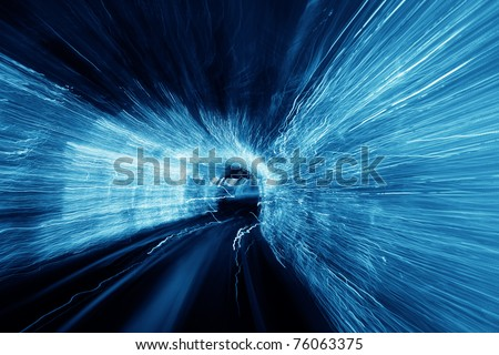 Abstract blurred speed motion light tunnel - stock photo