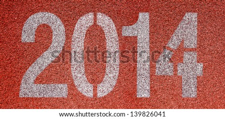"""""""2014"""" Abstract numbers on red running track - stock photo"""