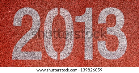 """""""2013"""" Abstract numbers on red running track - stock photo"""