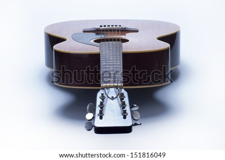 Acoustic guitar over white background