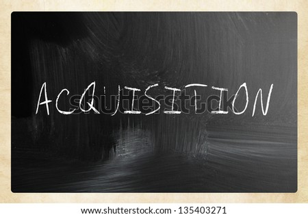 """Acquisition"" handwritten with white chalk on a blackboard - stock photo"