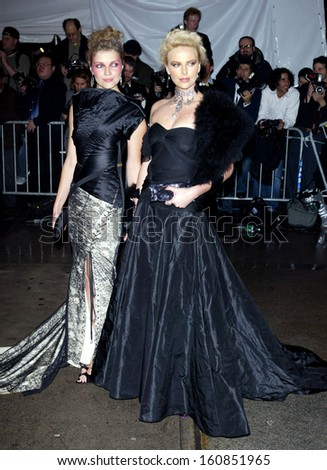 ,Actress Charlize Theron and friend arrive at the Costume Institute Party of the Year at the MET April 26, 2004 in New York City - stock photo