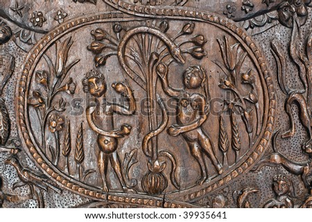 Adam and Eve in the Garden of Eden before the tree of knowledge. A fragment of an ancient wooden door in the Holy Sepulchre. Jerusalem. Isrsel. - stock photo