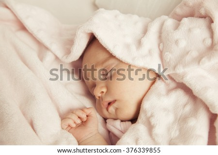 Adorable Newborn baby peacefully sleeping. Closeup Portrait. Studio shot, Horizontal - stock photo