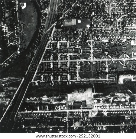 1956 aerial photograph of Love Canal showing a school and houses built over and near a landfill. Niagara Falls, New York. - stock photo
