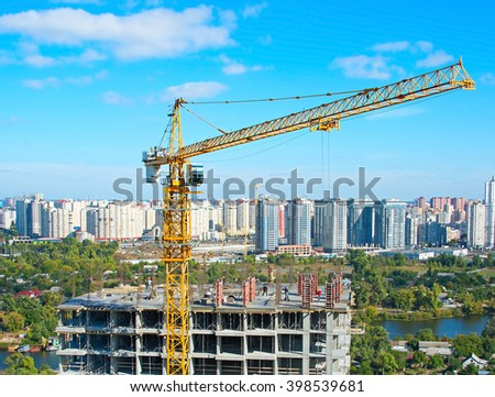 Aerial view of construction site with crane and workers in progress. Kiev, Ukraine - stock photo