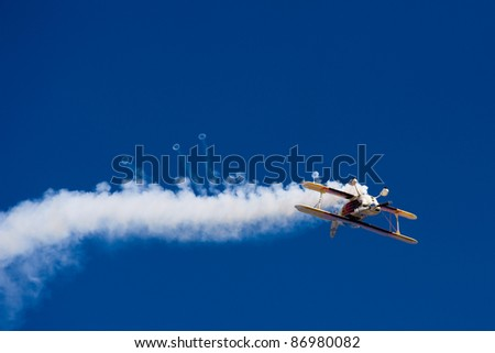 Aerobatic Plane in flight - stock photo