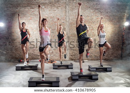 Aerobics class, group of people doing workout