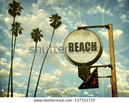 aged and worn vintage beach sign with palm trees - stock photo