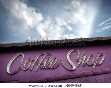 aged and worn vintage coffee shop sign                              - stock photo