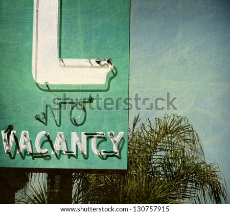 aged and worn vintage no vacancy sign - stock photo