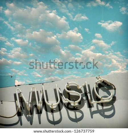aged and worn vintage photo neon music sign - stock photo