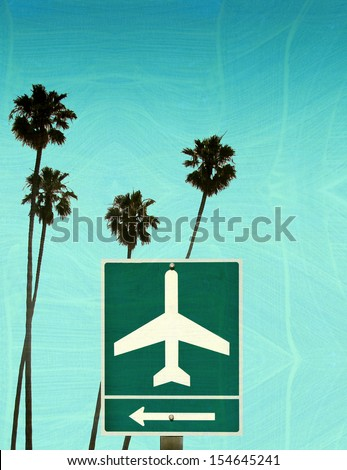 aged and worn vintage photo of airport sign with palm trees                             - stock photo