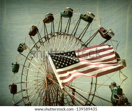 aged and worn vintage photo of american flag and ferris wheel. - stock photo
