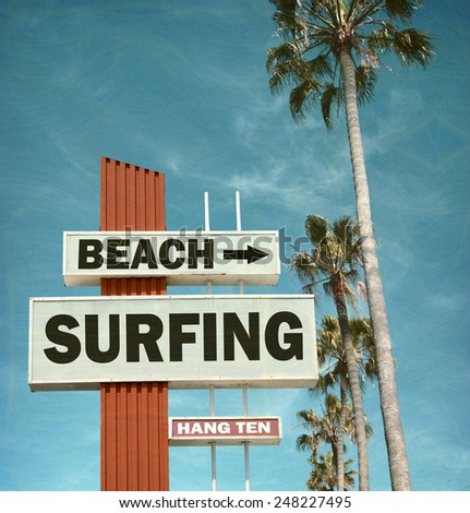 aged and worn vintage photo of beach surfing sign                           - stock photo