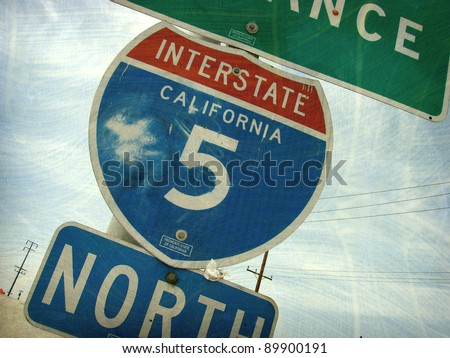 aged and worn vintage photo of california interstate freeway sign - stock photo