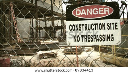 aged and worn vintage photo of danger construction site sign - stock photo