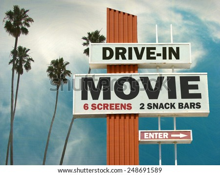 aged and worn vintage photo of  drive in movie sign with palm trees                               - stock photo