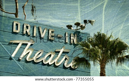 aged and worn vintage photo  of drive in theater - stock photo