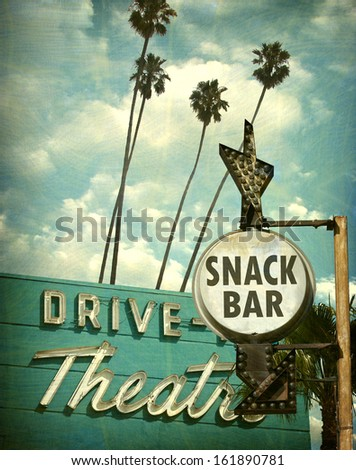 aged and worn vintage photo of drive in theater and snack bar sign                               - stock photo