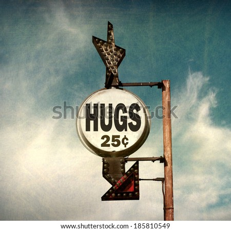 aged and worn vintage photo of hugs sign                              - stock photo