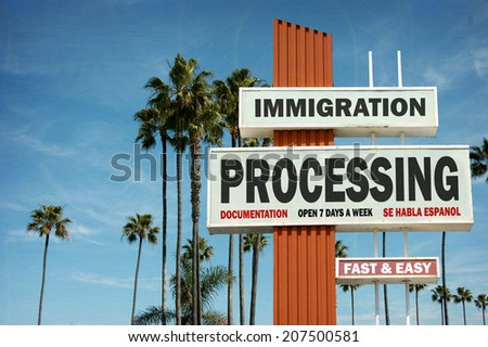 aged and worn vintage photo of immigration processing center with palm trees                              - stock photo