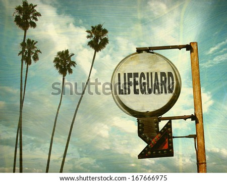 aged and worn vintage photo of lifeguard sign with palm trees                               - stock photo