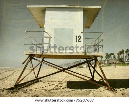 aged and worn vintage photo of lifeguard tower - stock photo