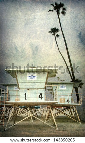aged and worn vintage photo of lifeguard tower on beach with palm trees - stock photo