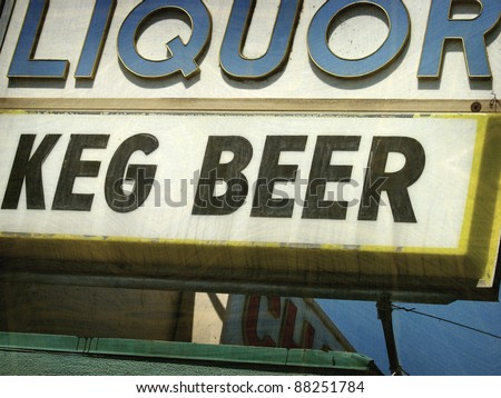 aged and worn vintage photo of  liquor store and beer sign - stock photo