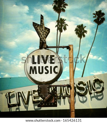 aged and worn vintage photo of live music sign                               - stock photo