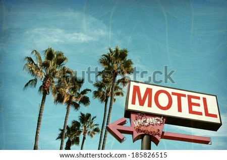 aged and worn vintage photo of motel sign palm trees                               - stock photo
