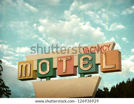 aged and worn vintage photo of motel vacancy sign - stock photo