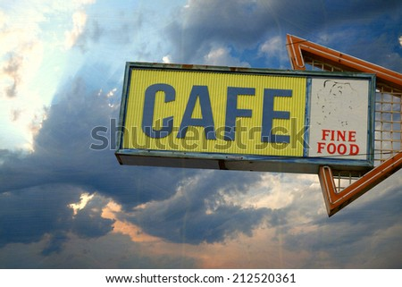 aged and worn vintage photo of neon cafe sign                             - stock photo