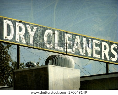 aged and worn vintage photo of neon dry cleaners sign
