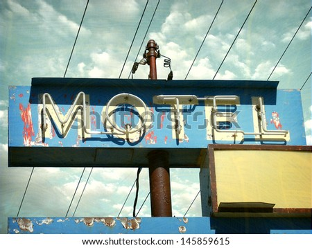 aged and worn vintage photo of neon motel sign                               - stock photo