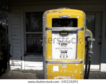 aged and worn vintage photo of old gas pump - stock photo