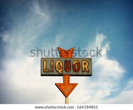 aged and worn vintage photo of old rusted neon sign                               - stock photo