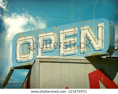 aged and worn vintage photo of open sign - stock photo