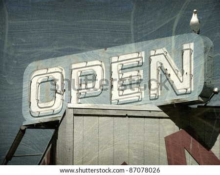 aged and worn vintage photo of open sign with seagull - stock photo