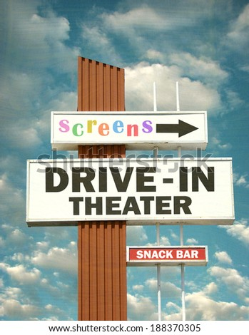 aged and worn vintage photo of retro drive in theater sign                                - stock photo