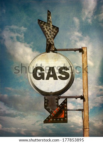 aged and worn vintage photo of retro gas sign                             - stock photo