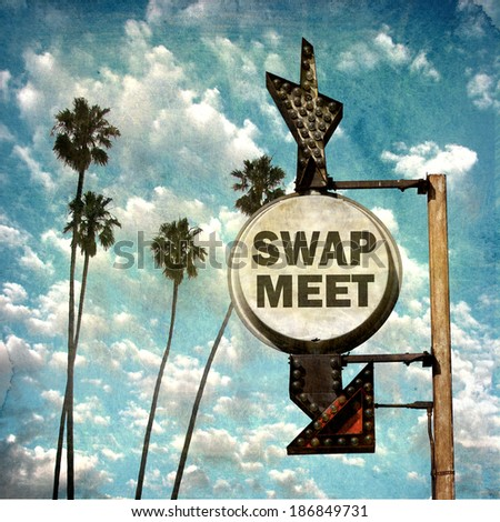 aged and worn vintage photo of swap meet sign with palm trees              - stock photo
