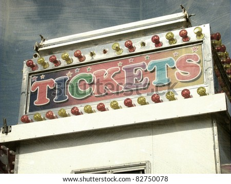 aged and worn vintage photo of ticket booth at carnival - stock photo