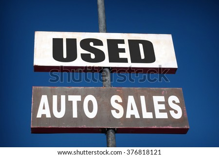 aged and worn vintage photo of used cars sign                              - stock photo