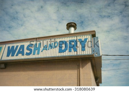 aged and worn vintage photo of wash and dry laundromat sign                             - stock photo